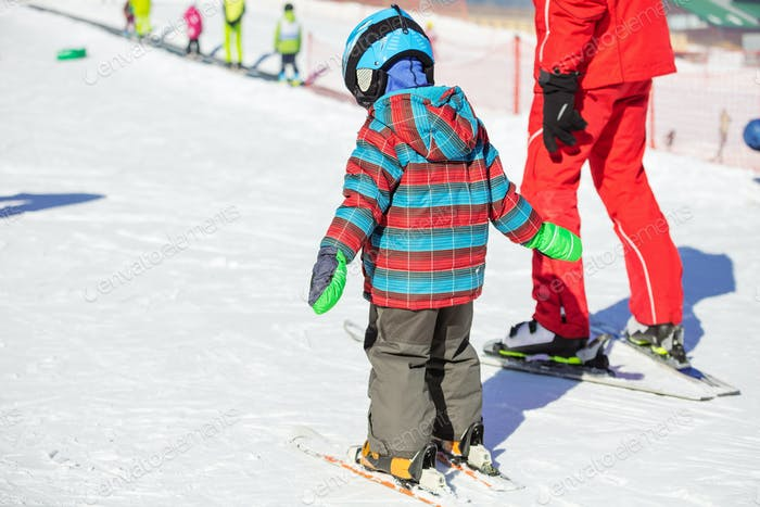 Young skier and ski instructor