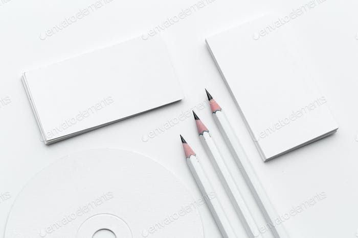 White blank business card. Office table desk with pencil. Top view and copy space for ad text