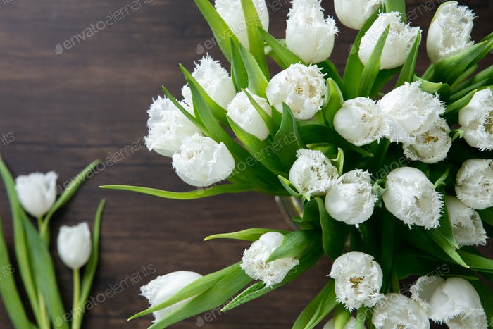 Close up of fashion modern bouquet of different flowers on wooden background