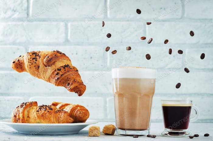 Different types of coffee with flying croissants. Espresso and m