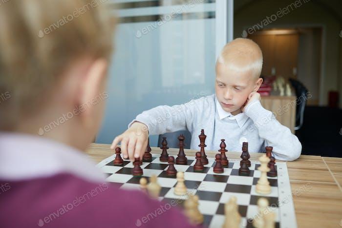 Chess game between schoolchildren
