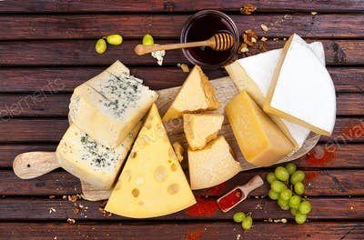 Cheese board. Various types of cheese. Top view
