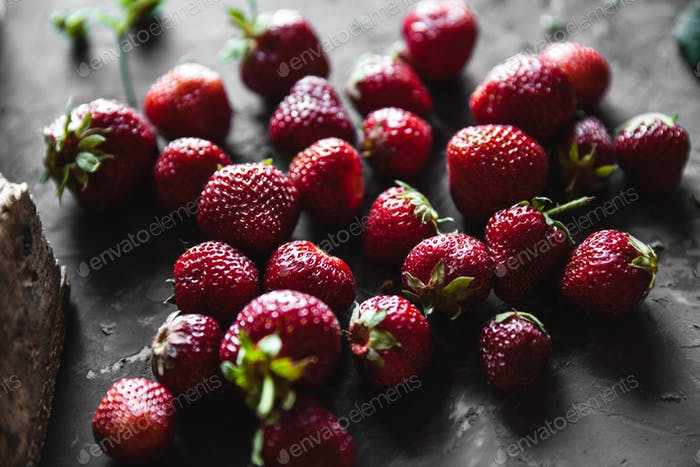 Fresh strawberry on dark grey background