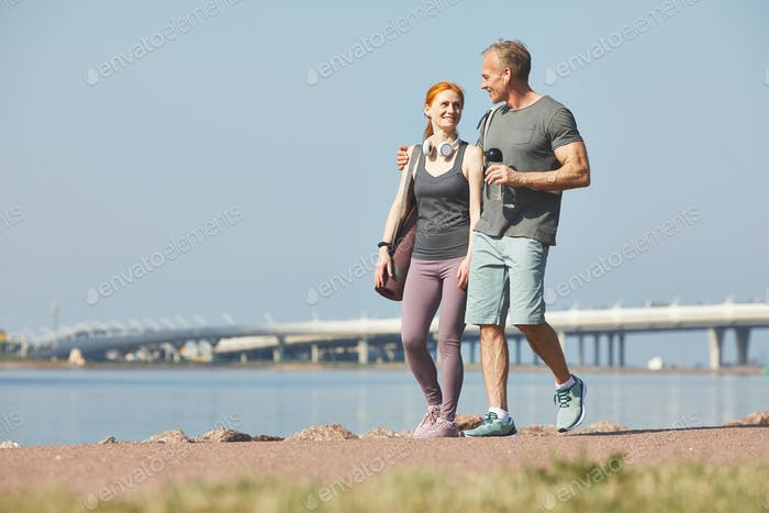 Affectionate couple walking over riverside