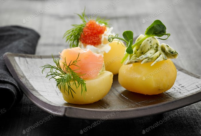 decorated boiled potatoes on plate