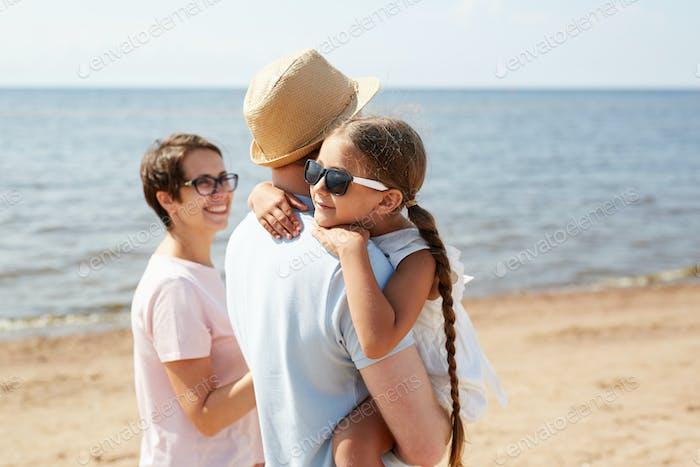 Family Enjoying Walk by Sea