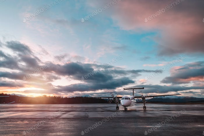 Airplane in sunset light