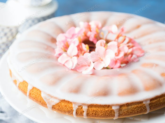 Bundt cake with frosting. Festive treat spring flowers