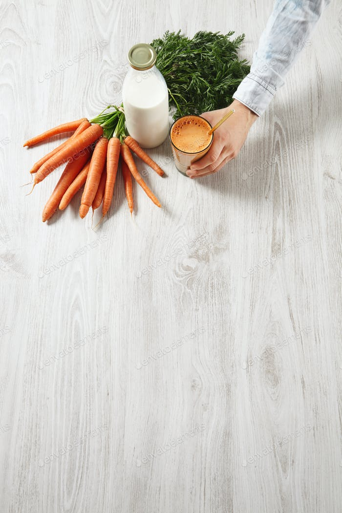 Side top view on wooden table, farm carrot harvest