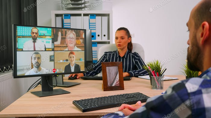 Immobilized freelancer discussing online with remotely colleagues