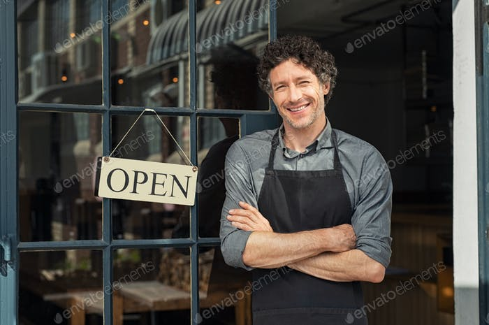 Owner standing outside restaurant