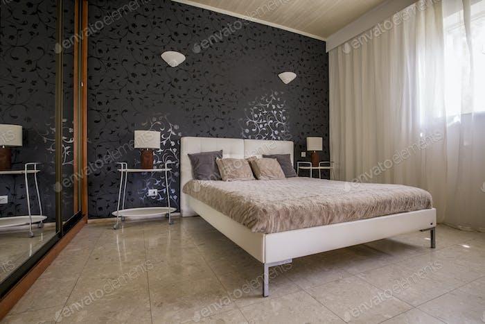 Elegant master bedroom with mirror