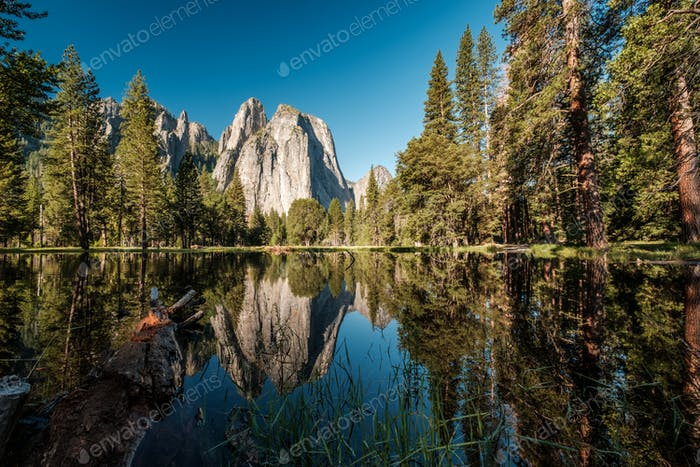 Middle Cathedral Rock reflecting in Merced River at Yosemite