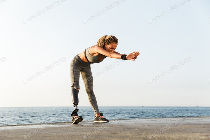 Full length of focused disabled athlete woman