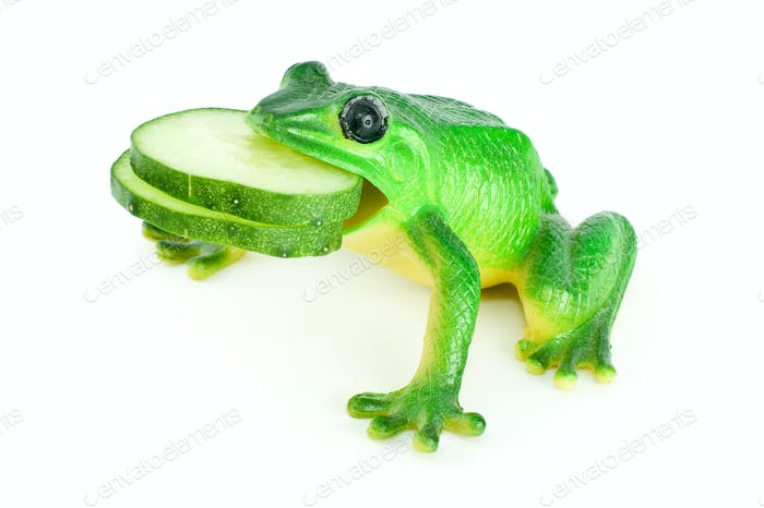 Toy frog with two cucumber slices in mouth