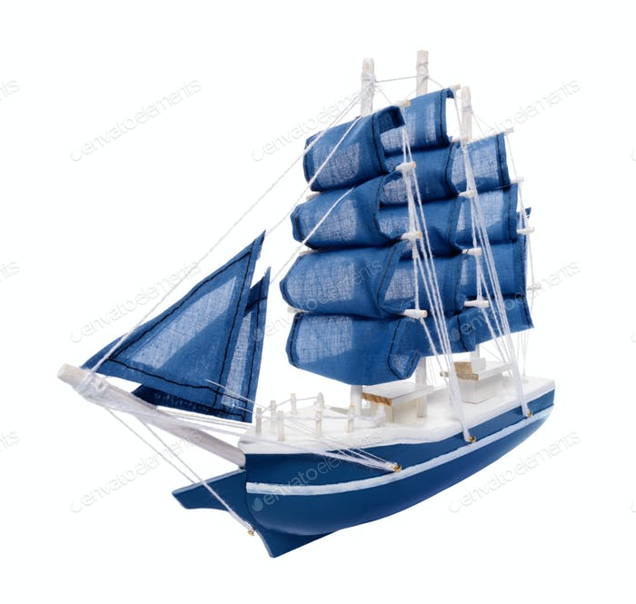 Blue sailboat with blue sails