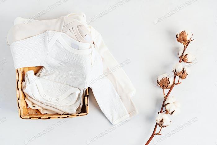 Cute newborn clothes. Organic cotton baby apparel mockup