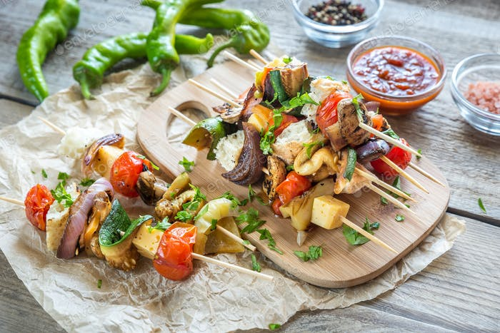 Grilled vegetable skewers on the wooden board