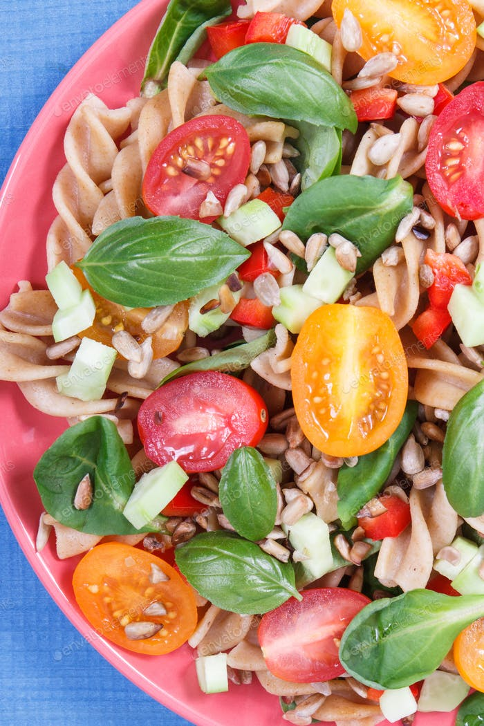 Fresh salad with wholegrain pasta and vegetables. Best food for dieting and slimming