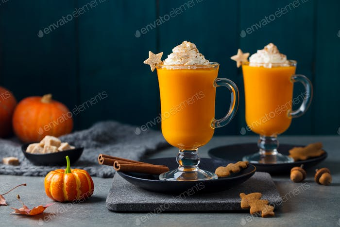 Pumpkin Latte with Spices. Boozy Cocktail with Whipped Cream. Grey Background.