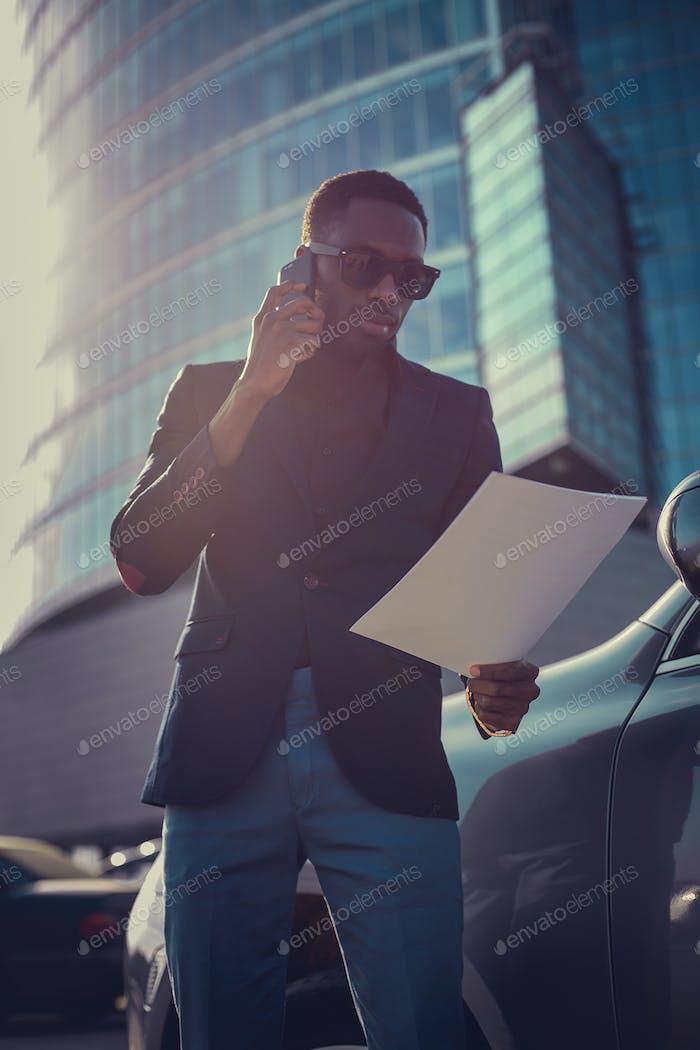 Modern black man in sunglasses.