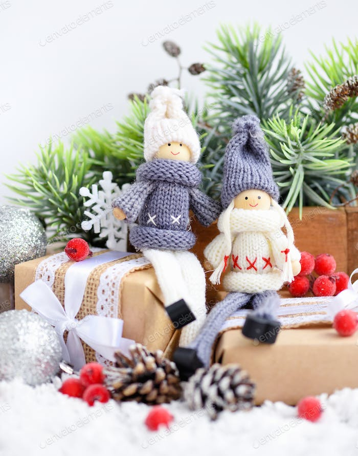 Christmas composition with toys dolls and spruce branches and fe