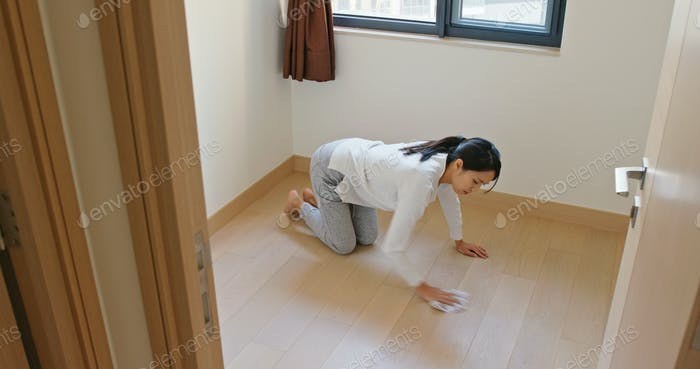 Housewife woman wash the floor with rag and feeling tired