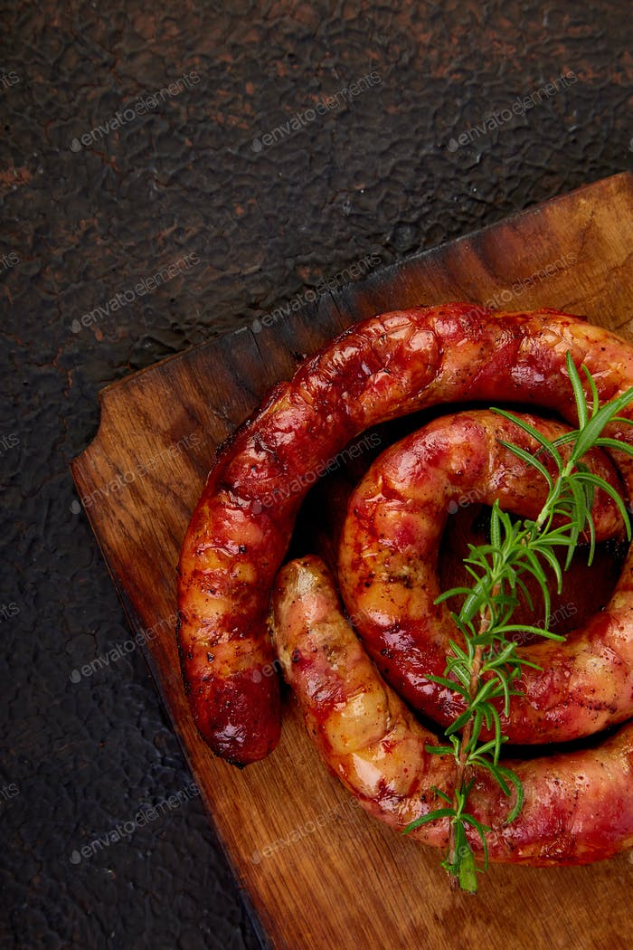 Grilled or Roasted spiral pork sausages with rosemary,