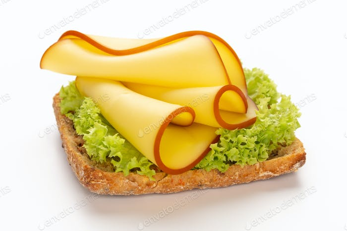 Sandwich with lettuce, cheese on white background.