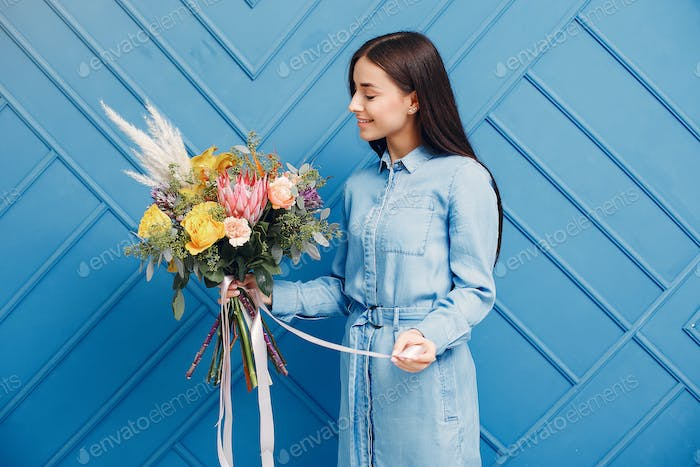 Frorist makes a beautiful bouquet in a studio