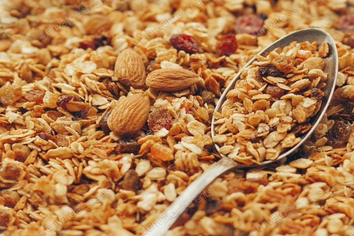 Delicious granola muesli with nuts and raising pattern,