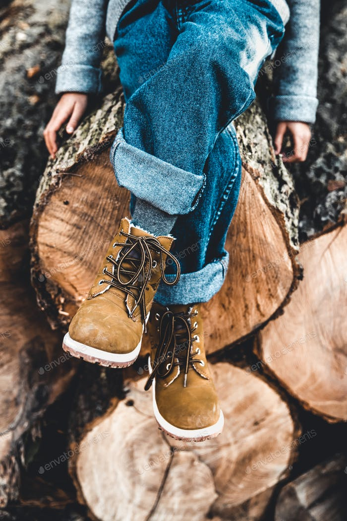 Boots on the top of the tree stump. Wood Background.Tree Picture