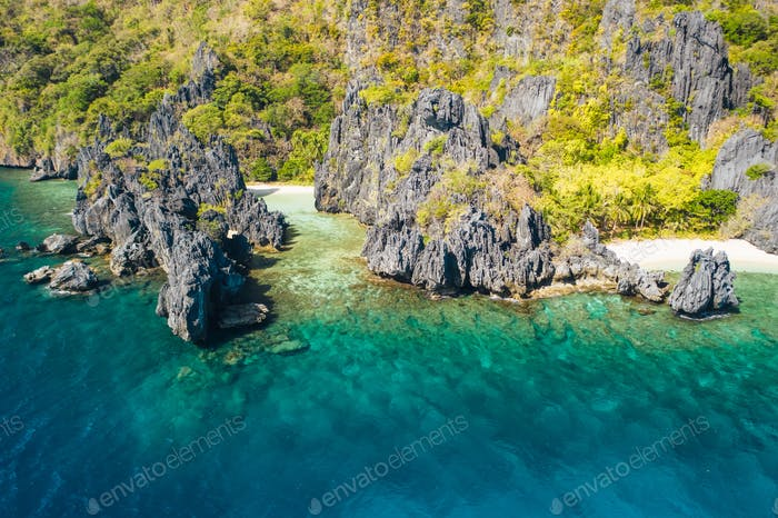 El Nido, Palawan Island. Hidden lagoon coastline. Limestone rock formations on famous tropical beach