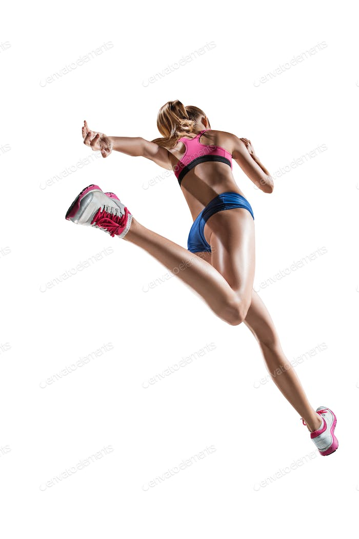 The studio shot of high jump female athlete is in action
