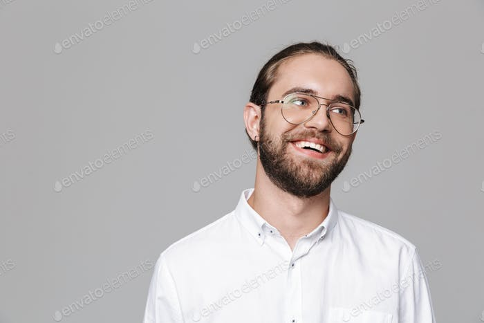 Bearded man posing isolated over grey wall background