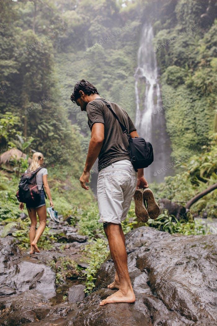 Young couple walking through mountain trail