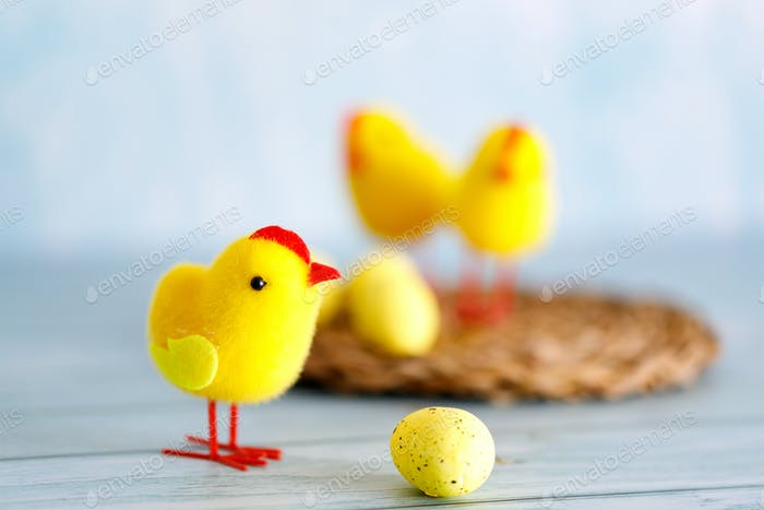Beautiful blue easter background with chicks.