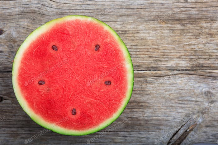 Half watermelon on a wooden table