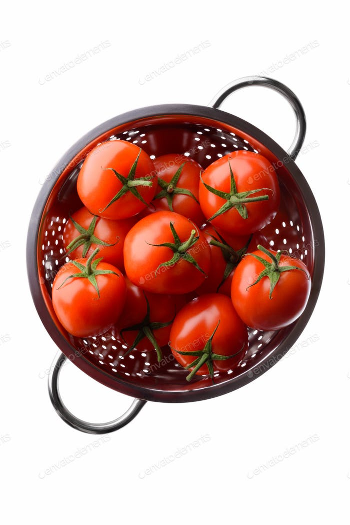 Red tomatoes in a colander