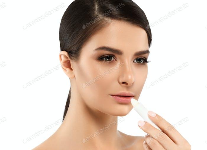 Woman lip balm lips care concept, beauty female portrait with healthy skin. Studio shot.
