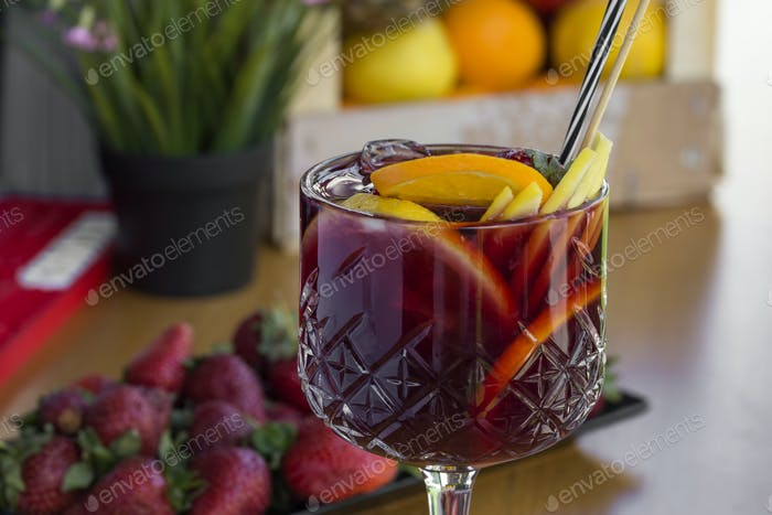 Cocktail with vodka, strawberries and lemon