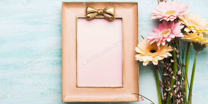 Beautiful flowers and pink frame on pastel green