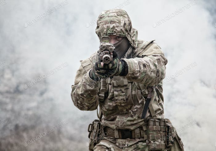 army soldier attacking enemies trough smoke screen