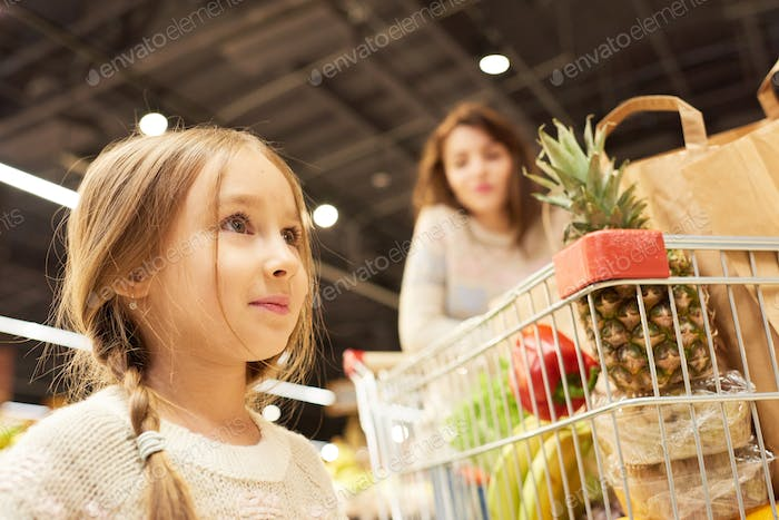 Little Girl Grocery Shopping with Mother