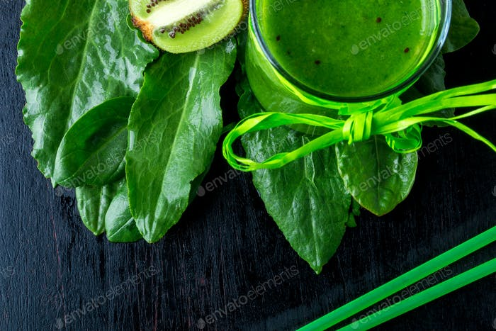 Green smoothie near ingredients