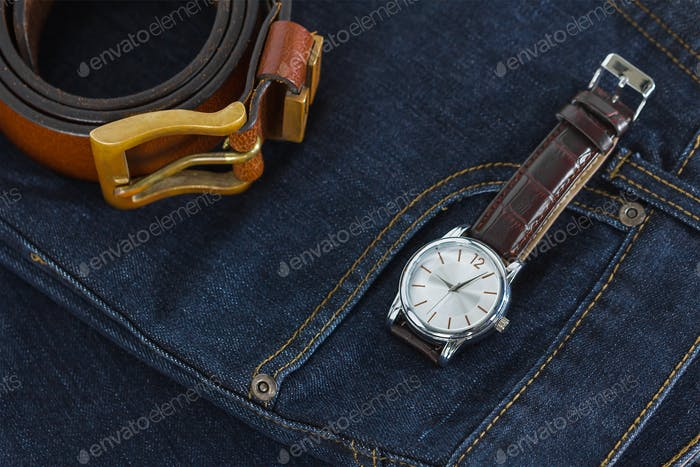 Wrist watch and leather belt on jeans-8