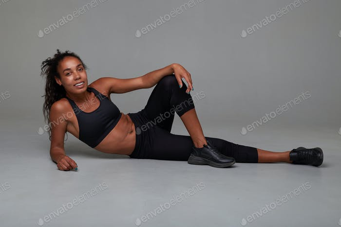 Full-length photo of sporty young dark skinned curly lady making small beak
