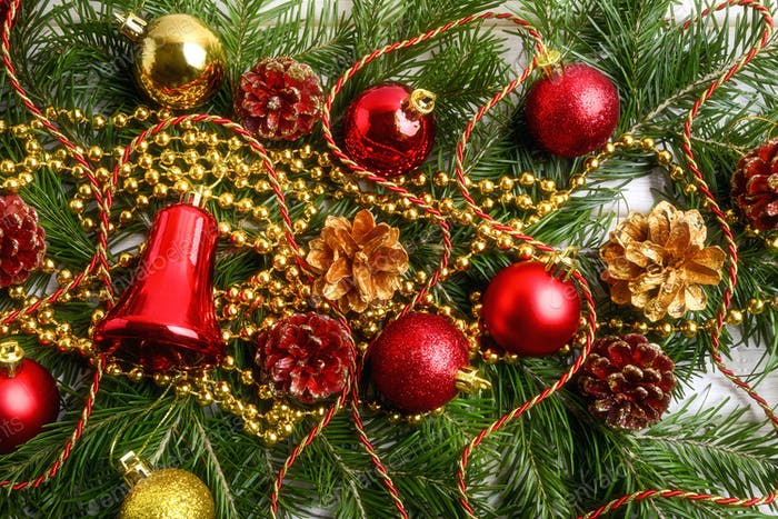 Christmas background with golden beads and red ornaments