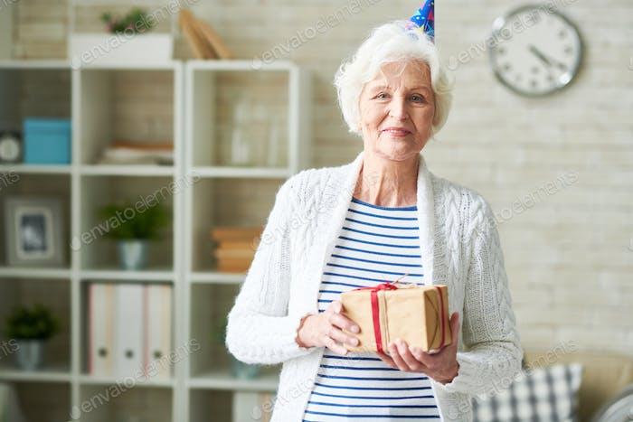 Happy Senior Lady Celebrating Birthday