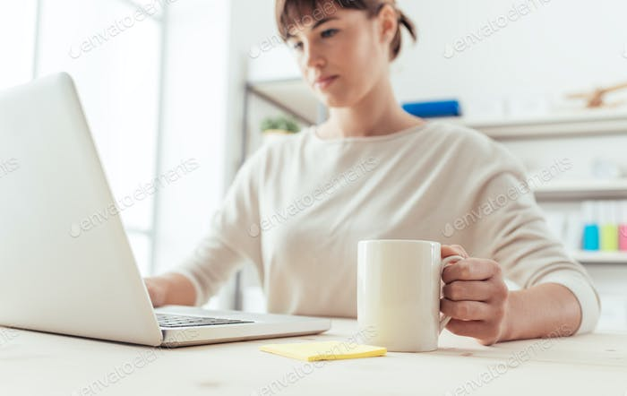 Woman having a coffee break and networking